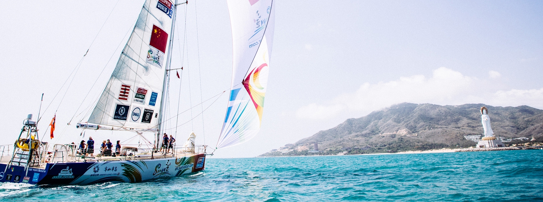 Sanya Serenity Coast taking part in a photoshoot with Sanya as backdrop