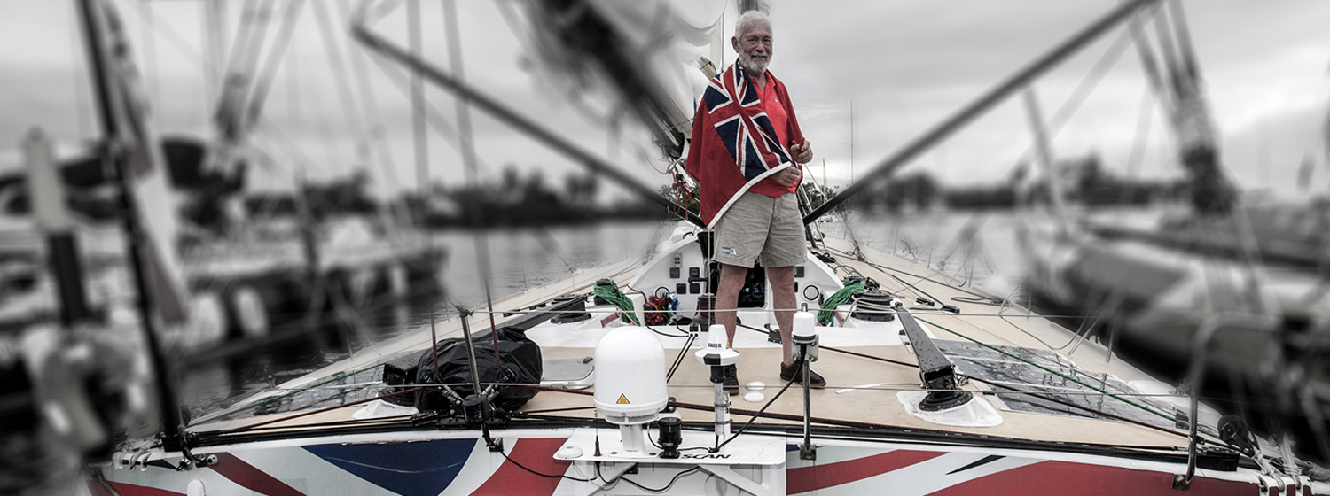 Sir Robin pictures standing on his open 60 yacht, Grey Power, at the end of the Route du Rhum. Picture: Breschi