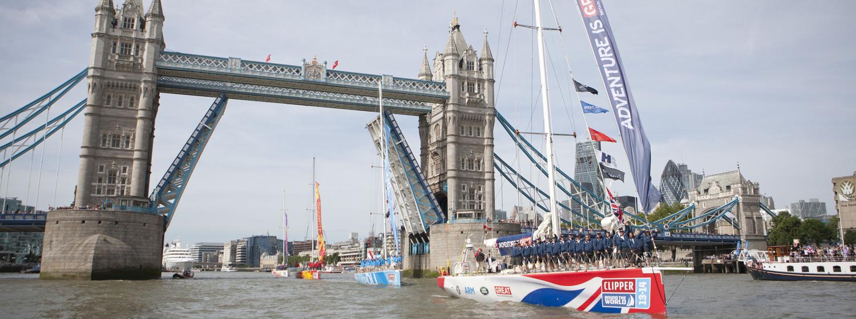 Clipper Race fleet pass under Tower Bridge London during 2013-14 race