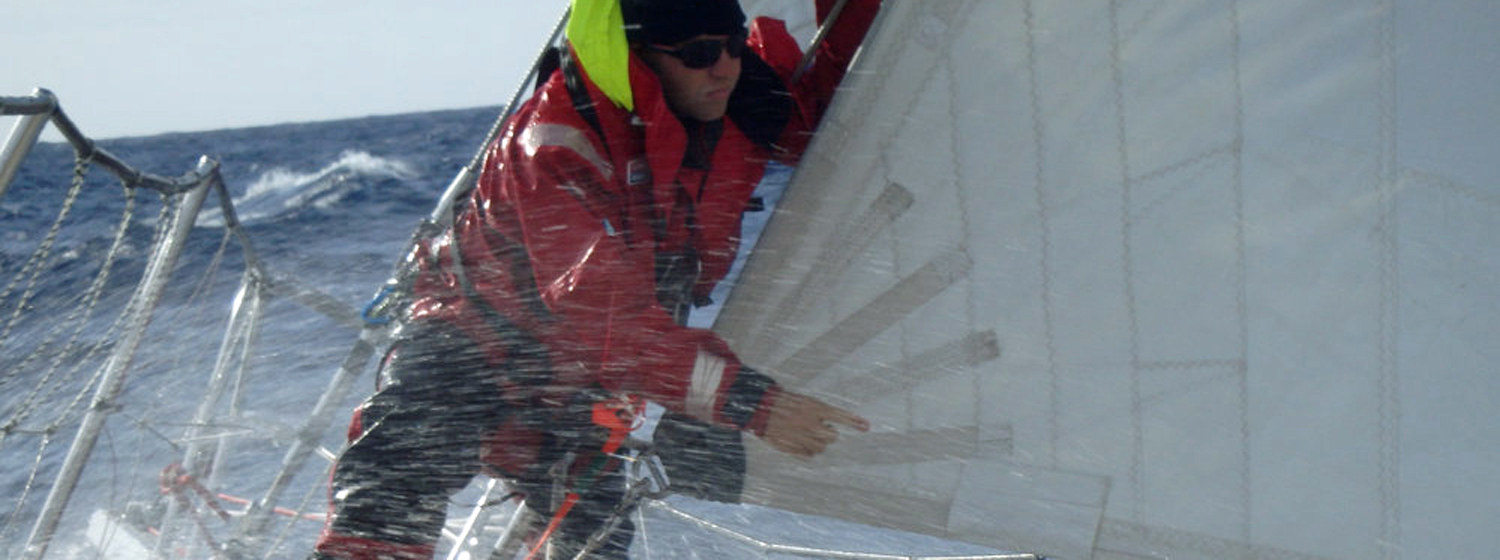 Could this be you? Crew member on bow on Clipper 70-foot ocean racing yacht with spray
