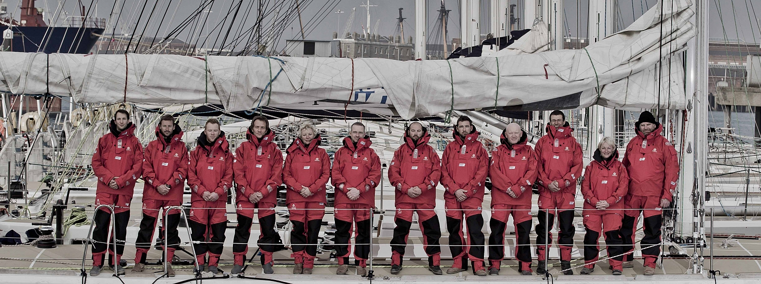The 2015-16 Clipper Race skippers line-up on a Clipper 70