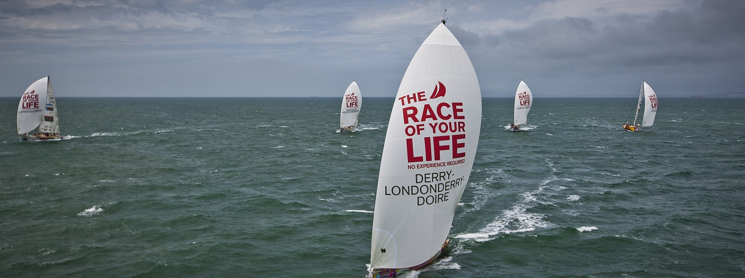 Clipper Race boats racing at sea