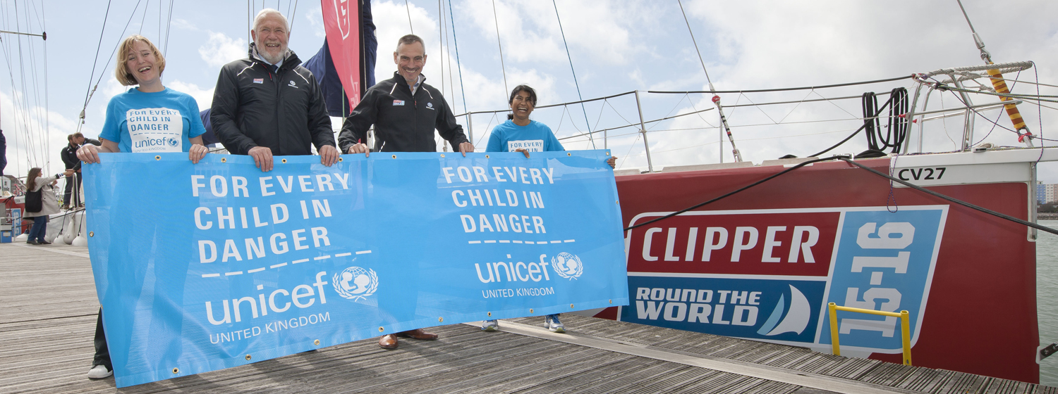 Sir Robin and William Ward pictured with Unicef team and banner