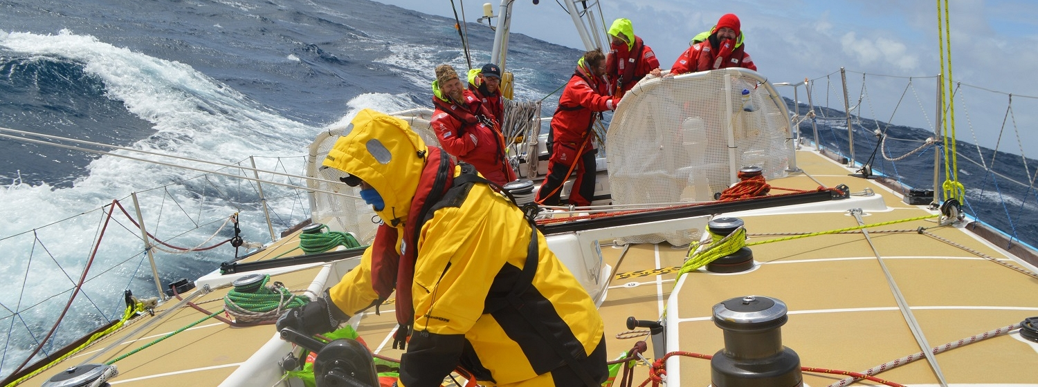 The crew of Unicef pictured working hard on board in mid Atlantic Ocean