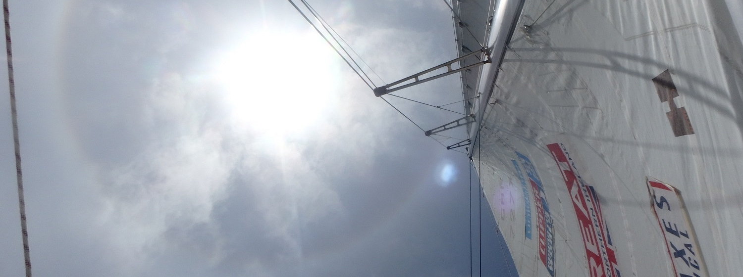 The sun shown shining strongly, looking upwards from GREAT Britain's mainsail