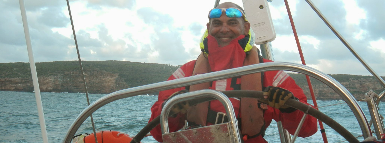 Deepak Pande behind the helm training for the Clipper Race
