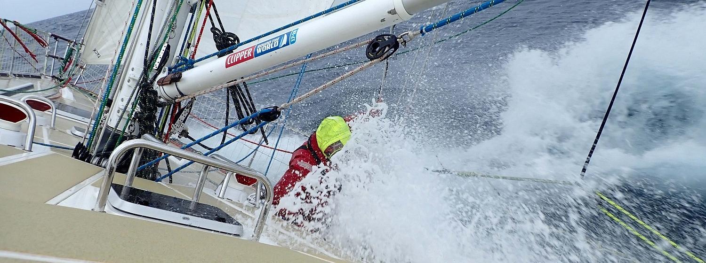 Wave crashing over boat