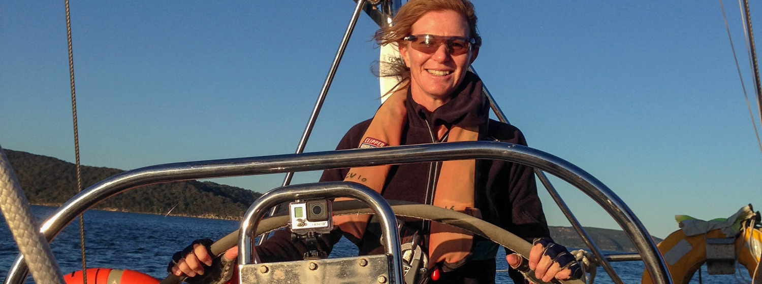 Nicolette Horak behind the helm on Clipper Race training