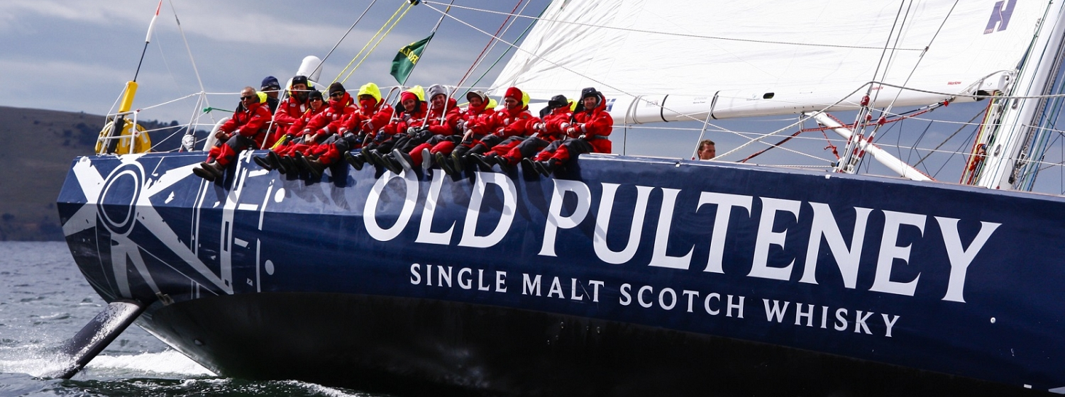 The Old Pulteney team shown celebrating with a whisky tasting session during the race