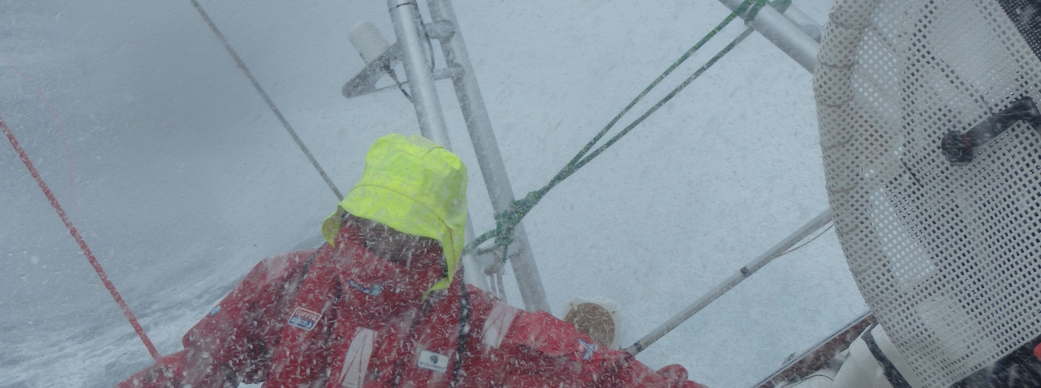 Crew member Nick Bush taking on the elements during the 2013-14 race.