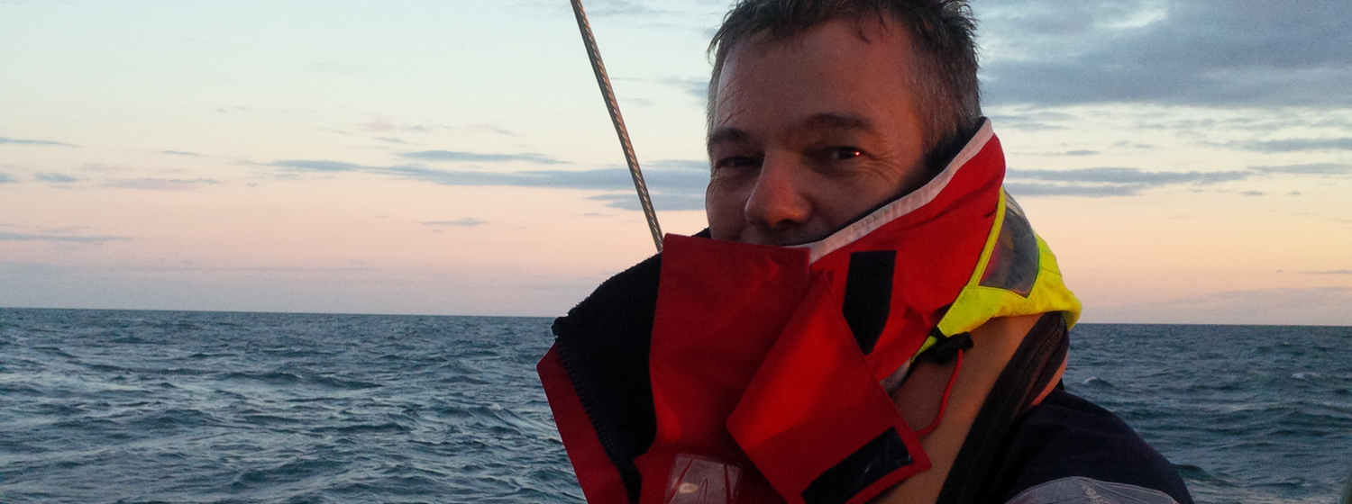 Clipper 2015-16 Race crew member Peter Fitch behind the helm during Clipper Race training