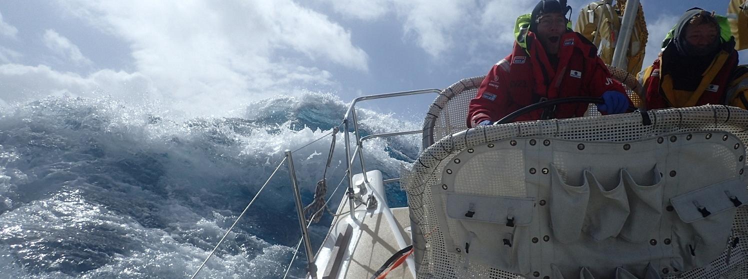 Crew member John Mccafrey on Visit Seattle helming in huge waves