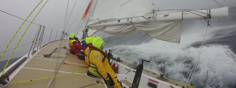 Crew wearing drysuits in wet racing conditions