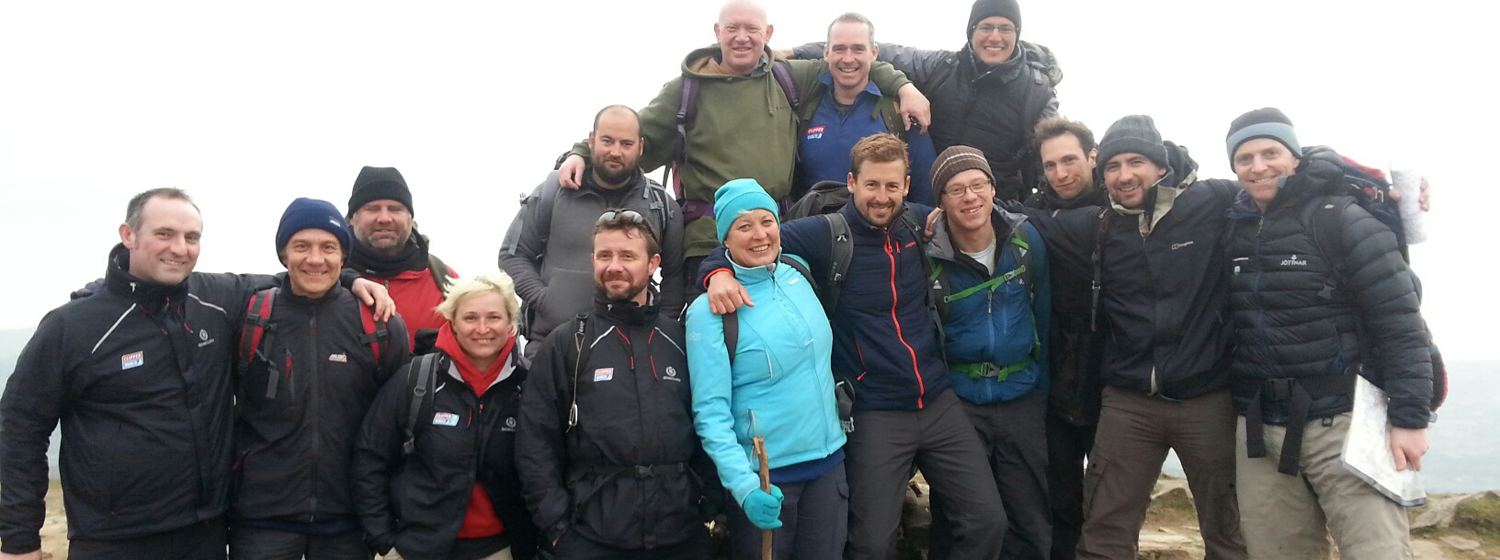 The 2015-16 race skippers pose together on top of Sugar Loaf Mountain, Wales